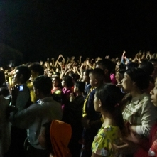Students and villagers enjoying music and dance performances